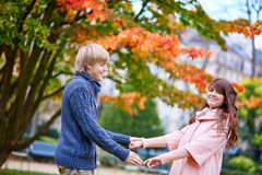 Young dating couple in Paris on a bright fall day Royalty Free Stock Photography