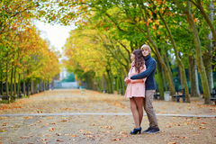 Young dating couple in Paris on a bright fall day Stock Image