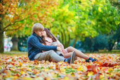 Young dating couple in Paris on a bright fall day Stock Images