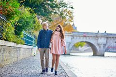 Young dating couple in Paris on a bright fall day stock photography