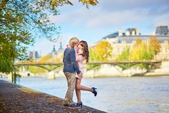 Young dating couple in Paris on a bright fall day stock photos