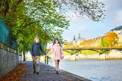 Young dating couple in Paris on a fall day Stock Image