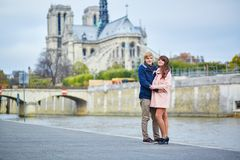 Young dating couple on the Seine embankment Stock Image