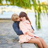 Young dating couple on the Seine embankment Stock Images