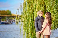 Young dating couple on the Seine embankment Royalty Free Stock Photos