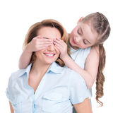 Young daughter closes hands eyes mom Royalty Free Stock Photography