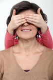 Daughter covering mother's face Stock Photo