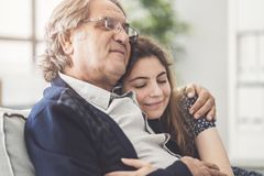 Young daughter hugs her father royalty free stock photo