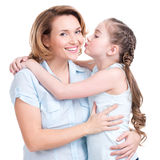Young daughter  kissing mother Stock Photo