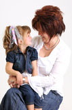 Young daughter and mother smiling Stock Images