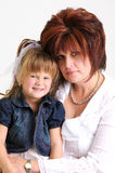 Young daughter and mother smiling Royalty Free Stock Image