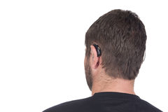 Young deaf or hearing impaired man with cochlear implant and hea. Ring aid photographed from behind to show device Stock Photos