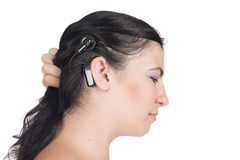 Young deaf or hearing impaired woman with cochlear implant. Young deaf or hearing impaired woman showing her cochlear implant Royalty Free Stock Image