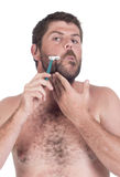 Young deaf man shaving Royalty Free Stock Image