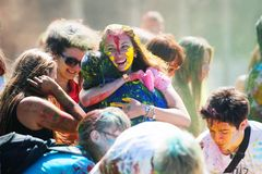 Young, decorated people participate in the Holi festival of colors in Vladivostok. royalty free stock photo