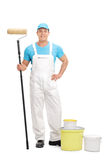 Young decorator holding a paint roller Royalty Free Stock Images