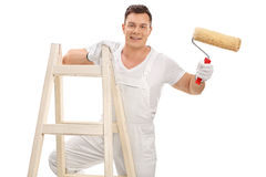 Young decorator holding a paint roller Stock Photography