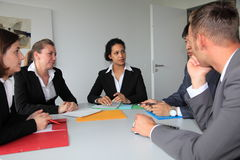 Young dedicated business team in a meeting Stock Photo
