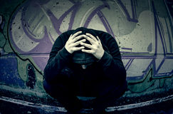 Young dejected street. Boy rapper desperate urban street royalty free stock photo