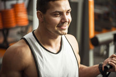 Young delighted man smiling in a gym Royalty Free Stock Photography