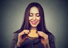 Content young woman anticipating hamburger royalty free stock photography