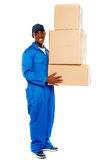 Young delivery boy holding cardboard boxes Stock Photo