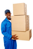 Young delivery guy holding stack of parcel boxes Royalty Free Stock Photos