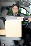 Young delivery man in the car. Royalty Free Stock Photography