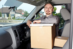 Young delivery man in the car. Royalty Free Stock Photos