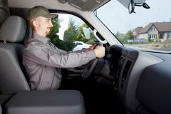 Young delivery man in a car. Stock Image