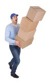 Young delivery man with falling boxes Royalty Free Stock Image
