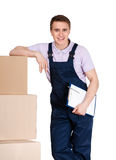 Young delivery man in overalls with boxes Stock Photos