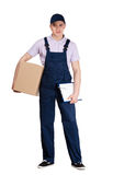 Young delivery man in overalls hands parcel box. Young delivery man in blue overalls and blue peaked cap hands parcel box, isolated on white Stock Photography