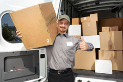 Young delivery man with a parcel. Stock Image