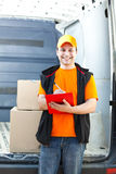 Young delivery man portrait at work Royalty Free Stock Images