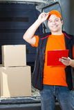 Young delivery man portrait at work Stock Photo