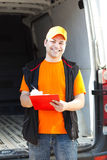 Young delivery man portrait at work Stock Photography