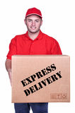 Young delivery man in red uniform holding the box Stock Images