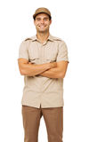 Young Deliveryman Standing Arms Crossed Stock Photo