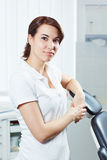 Young dental assistant in dental practice Stock Photo