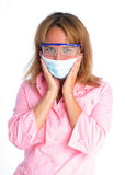 Young dentist in a mask and protective glasses Stock Image