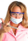 Young dentist in a mask and protective glasses, ho Stock Image