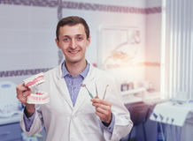 Young dentist in the office Stock Image