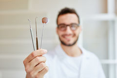Young dentist with tools. And dental instruments Stock Photography