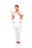 Young dentist woman with toothbrush and tooth model Royalty Free Stock Images