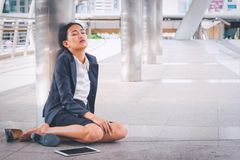 Young depressed businesswoman sitting on the floor stock photography