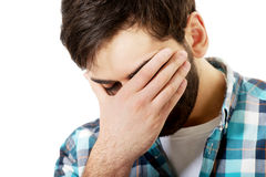 Young depressed man touching his face. Stock Photos