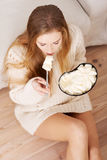 Young depressed woman is eating big bowl of ice creams to comfor Stock Photo