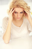 Young depressed woman at home Stock Photos