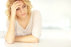Young depressed woman at home Stock Photo